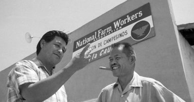 United Farm Workers leader Cesar Chavez, left, who led the fight as head of the AFL-CIO union local, talks with his assistant Larry Itliong, in front of union headquarters at Delano, Calif., July 28, 1967.  (AP Photo/Harold Filan)